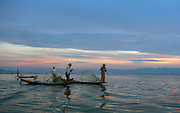 Spear fishermen working with the aid of baskets on Inle Lake. Inle Lake a freshwater lake located in the Nyaungshwe Township of Taunggyi District of Shan State, part of Shan Hills in Myanmar (Burma).