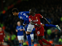 Football - 2019 / 2020 Premier League - Liverpool vs. Everton<br /> <br /> Mason Holgate of Everton beats Sadio Mane of Liverpool in midfield, at Anfield.<br /> <br /> COLORSPORT/ALAN MARTIN