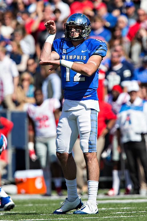 MEMPHIS, TN - OCTOBER 17:  Paxton Lynch #12 of the Memphis Tigers signals to the receivers during a game against the Ole Miss Rebels at Liberty Bowl Memorial Stadium on October 17, 2015 in Memphis, Tennessee.  The Tigers defeated the Rebels 37-24.  (Photo by Wesley Hitt/Getty Images) *** Local Caption *** Paxton Lynch