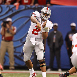 January 4, 2011; New Orleans, LA, USA;  Ohio State Buckeyes quarterback Terrelle Pryor (2) passes during the third quarter of the 2011 Sugar Bowl against the Arkansas Razorbacks at the Louisiana Superdome.  Mandatory Credit: Derick E. Hingle