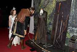 © Licensed to London News Pictures. 09/02/2015. London, UK. People dressed as characters from the series look at exhibits at the Game of Thrones Exhibition on 9th February 2014 at the O2 Arena in Greenwich, south-east London. Photo credit : Vickie Flores/LNP