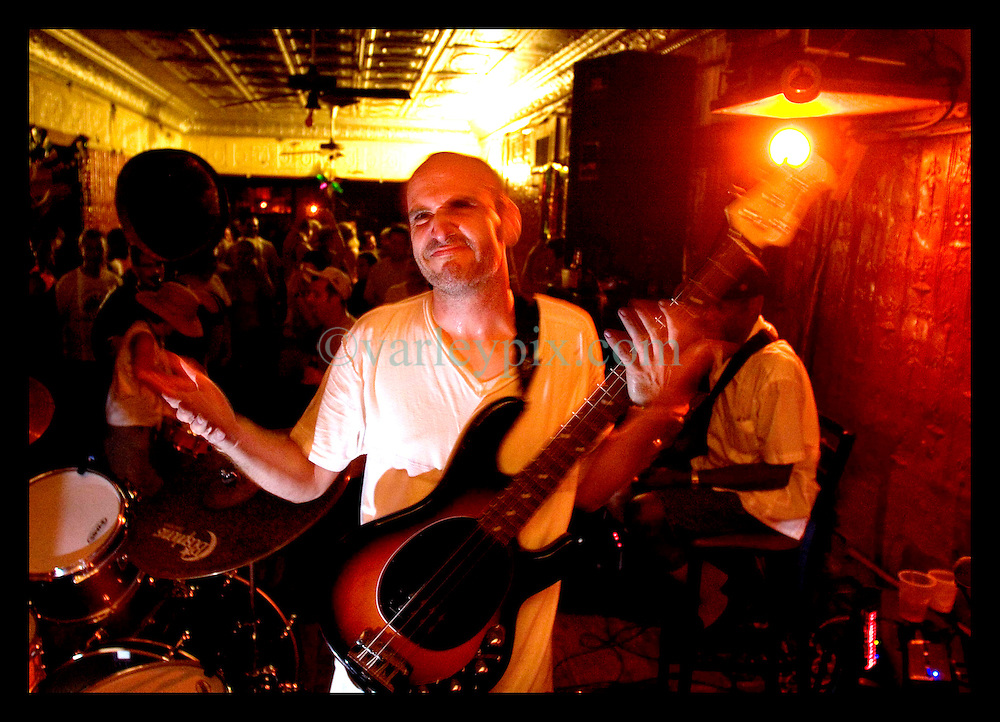 30th Sept, 2005. Hurricane Katrina aftermath, New Orleans, Louisiana. Music returns to the city at the infamous Maple Leaf bar in Uptown New Orleans. Legendary local jazz man Walter 'The Wolfman' Washington (rt) and Tom McDonald (mid) play to residents, some of whom fled the storm and others who rode it out.