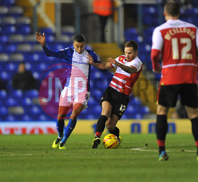 Birmingham City's Jesse Lingard battles for the ball with Doncaster Rovers' Luke McCullough - Photo mandatory by-line: Alex James/JMP - Tel: Mobile: 07966 386802 03/12/2013 - SPORT - Football - Birmingham - St Andrews - Birmingham City v Doncaster Rovers - Sky Bet Championship
