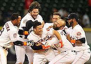 Apr 30, 2015; Houston, TX, USA; Houston Astros teammates celebrate Houston Astros second baseman Jose Altuve (27) game-winning RBI hit against the Seattle Mariners in the bottom of the 10th inning at Minute Maid Park. The Astros won 3 o 2. Mandatory Credit: Thomas B. Shea-USA TODAY Sports