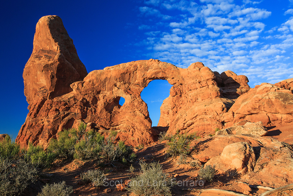 Shortly after sunrise the clouds came in adding to the view of Turret Arch in Arches National Park, Utah