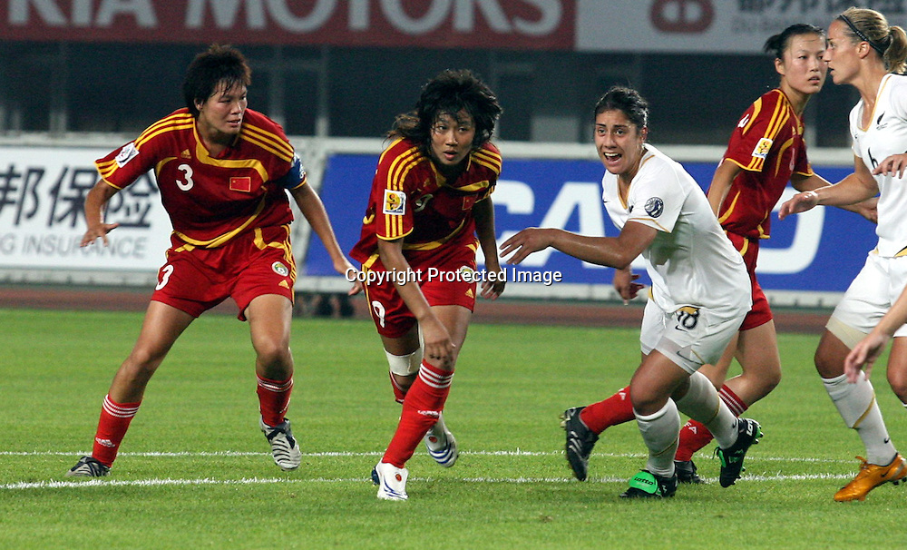 Renee Leota (NZ) chases the ball during the Women's Friendly football match between New Zealand and China, held in China, 22 July 2008. Photo: ChinaFotoPress