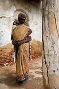 Woman at abandoned house on road between Nagapattinam and Nagore.