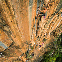 Jose Pereyra climbs Mind the Owl, 5.10d, Ban Pak Ou, Luang Phrabang, Laos