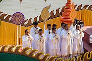 "05 FEBRUARY 2013 - PHNOM PENH, CAMBODIA:  Brahmin priests from the Royal Court blow conch shells announcing the arrival of the ashes of King Father Norodom Sihanouk abroad the barge. Sihanouk's ashes will be scattered in locations across Cambodia. Tuesday, they were scattered on the Mekong River. Norodom Sihanouk (31 October 1922 - 15 October 2012) was the King of Cambodia from 1941 to 1955 and again from 1993 to 2004. He was the effective ruler of Cambodia from 1953 to 1970. After his second abdication in 2004, he was given the honorific of ""The King-Father of Cambodia."" Sihanouk died in Beijing, China, where he was receiving medical care, on Oct. 15, 2012.   PHOTO BY JACK KURTZ"
