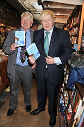 Left to right, STANLEY JOHNSON and his son Mayor of London BORIS JOHNSON at a party to celebrate the publication of Stanley Johnson's new book 'Where The Wild Things Were' held at Daunt Books, 83 Marylebone High Street, London W1 on 18th July 2012.