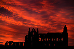 © Licensed to London News Pictures. 26/07/2017. Whitby UK. Picture shows last night's stunning sunset behind the gothic ruins of Whitby Abbey on the Yorkshire Coast. Photo credit: Andrew McCaren/LNP