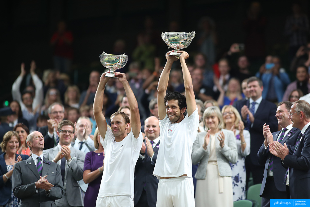 LONDON, ENGLAND - JULY 15: Lucasz Kubot of Poland and Marcelo Melo of Brazil celebrate with their trophies after winning the Men's Doubles Final on Center Court during the Wimbledon Lawn Tennis Championships at the All England Lawn Tennis and Croquet Club at Wimbledon on July 15, 2017 in London, England. (Photo by Tim Clayton/Corbis via Getty Images)