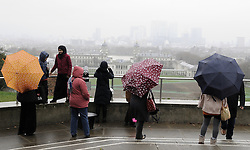 © Licensed to London News Pictures. 29/12/2012.Wet weather (today 29.12.12) in Greenwich Park,Greenwich, London. .Umbrellas up in Greenwich park as tourists take in views of London..today.Photo credit : Grant Falvey/LNP