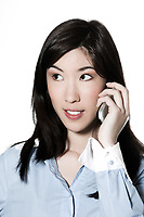 studio shot portrait of a beautiful southeast asian young woman phoning