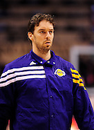 Feb. 19, 2012; Phoenix, AZ, USA;  Los Angeles Lakers forward Pau Gasol (16) reacts on the court while playing Phoenix Suns at the US Airways Center.  The Suns defeated the Lakers 102-90. Mandatory Credit: Jennifer Stewart-US PRESSWIRE.