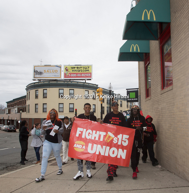 "Boston area low wage workers are joined by, BU students and adjuncts, airport workers, health care workers, and other fast food workers in a series of actions that call to ""Fight For $15"" outside of McDonald in Codman Sq, Dorchester, MA on April 14, 2015."
