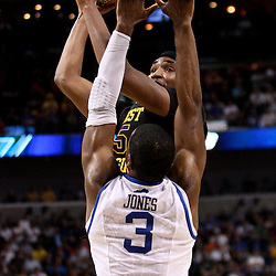 Mar 19, 2011; Tampa, FL, USA; West Virginia Mountaineers forward Kevin Jones (5) shoots over Kentucky Wildcats forward Terrence Jones (3) during the first half of the third round of the 2011 NCAA men's basketball tournament at the St. Pete Times Forum.  Mandatory Credit: Derick E. Hingle