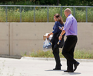 Two people who did not want to be identified walk out of PFGBest in Cedar Falls, Iowa on Tuesday, July 10, 2012.