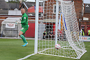 Mansfield Town goalkeeper Brian Jensen watches helplessly as York City forward Reece Thompson scores  during the Sky Bet League 2 match between York City and Mansfield Town at Bootham Crescent, York, England on 29 August 2015. Photo by Simon Davies.