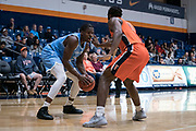 Cal State Fullerton Titans guard Brandon Kamga (1) defends against San Diego Toreros forward James Jean-Marie (23) during an NCAA basketball game, Wednesday, Dec. 11, 2019, in Fullerton, Calif. San Diego defeated CSUF 66-54. (Jon Endow/Image of Sport)