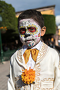 A young boy dressed as a mariachi skeleton for Day of the Dead festival in San Miguel de Allende, Guanajuato, Mexico. The week-long celebration is a time when Mexicans welcome the dead back to earth for a visit and celebrate life.