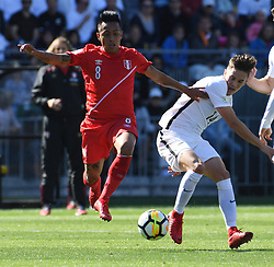 Peru's Christian Cueva, left, contests the ball with New Zealand's Ryan Thomas in the Soccer World Cup qualifying match, Westpac Stadium, Wellington, New Zealand, Saturday, November 11, 2017. Credit:SNPA / Ross Setford  **NO ARCHIVING**