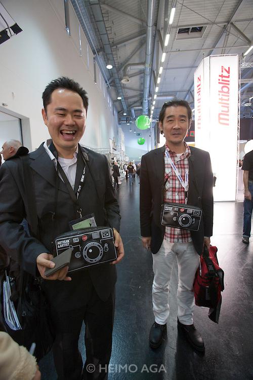 Photokina 2008, World's bigest bi-annual photo fair. Two friendly Japanese photo artists.
