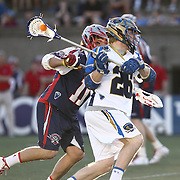 John Haus #26 of the Charlotte Hounds looks to shoo the ball during the game at Harvard Stadium on May 17, 2014 in Boston, Massachuttes. (Photo by Elan Kawesch)
