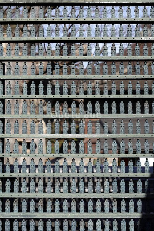 rows of mini Buddhas at Zenkoji Shrine Nagano Japan