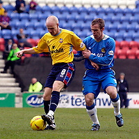 Photo. Jed Wee.<br /> Wigan Athletic v Crystal Palace, Nationwide League Division One, JJB Stadium, Wigan. 01/11/03.<br /> Palaces' Tony Popovic (L) holds off Wigan's Steve McMillan.