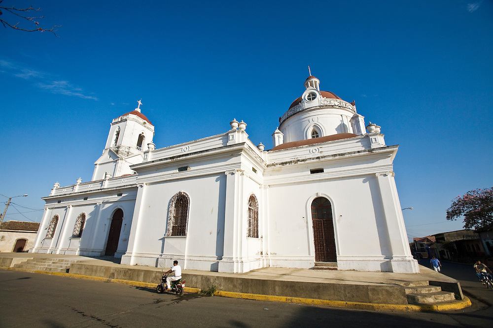 Church in Masaya. Masaya is located close to Granada, Nicaragua. It is a regional transportation hub and a famous market town where the products of the artisans of the surrounding towns are sold.