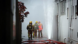 Fire and emergency crews are at a 4th alarm blaze which ripped through a print and supply'warehose in Onehunga, Auckland, New Zealand, Saturday, September 30, 2017. Credit:SNPA / Hayden Woodward **NO ARCHIVING**