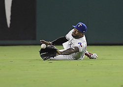 September 12, 2017 - Arlington, TX, USA - Texas Rangers center fielder Delino DeShields is unable to catch a pop fly single by the Seattle Mariners' Mike Zunino during the seventh inning at Globe Life Park in Arlington, Texas, on Tuesday, Sept. 12, 2017. (Credit Image: © Max Faulkner/TNS via ZUMA Wire)