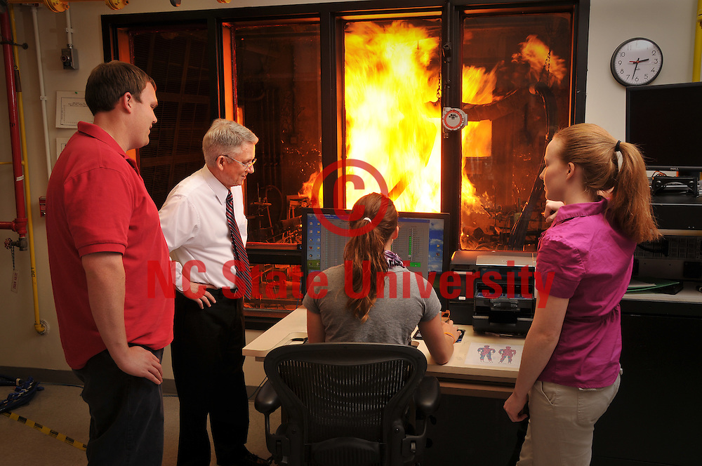 Dr. Roger Barker and students in the College of Textiles's Textile Protection and Comfort Center (TPACC).