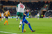 Allan McGregor of Hull City body checks Kieffer Moore of Barnsley during the EFL Sky Bet Championship match between Hull City and Barnsley at the KCOM Stadium, Kingston upon Hull, England on 27 February 2018. Picture by Craig Zadoroznyj.
