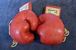 © Licensed to London News Pictures. 14/05/2017. London, UK. A pair of boxing gloves worn and signed by Muhammad Ali in the World Heavyweight Championship bout with Joe Bugner in Kuala Lumpur on 30 June 1975 are presented at a press preview.  The red Winning S.S. FP-800, Tokyo, 10oz. boxing gloves with original lacing are offered by Graham Budd Auctions at Sotheby's on a sale of Sporting Memorabilia on 15 May 2017.  Photo credit : Stephen Chung/LNP