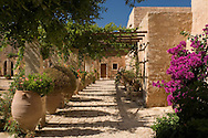 Terracotta urns and flowers in the cloister at Arkadhi Monastery ( Moni Arkadhi)<br /> twenty-five miles from Rethymnon,Crete, Greece