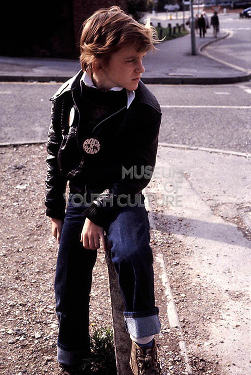 Neville with rock and roll badge. High Wycombe, UK. 1980s.
