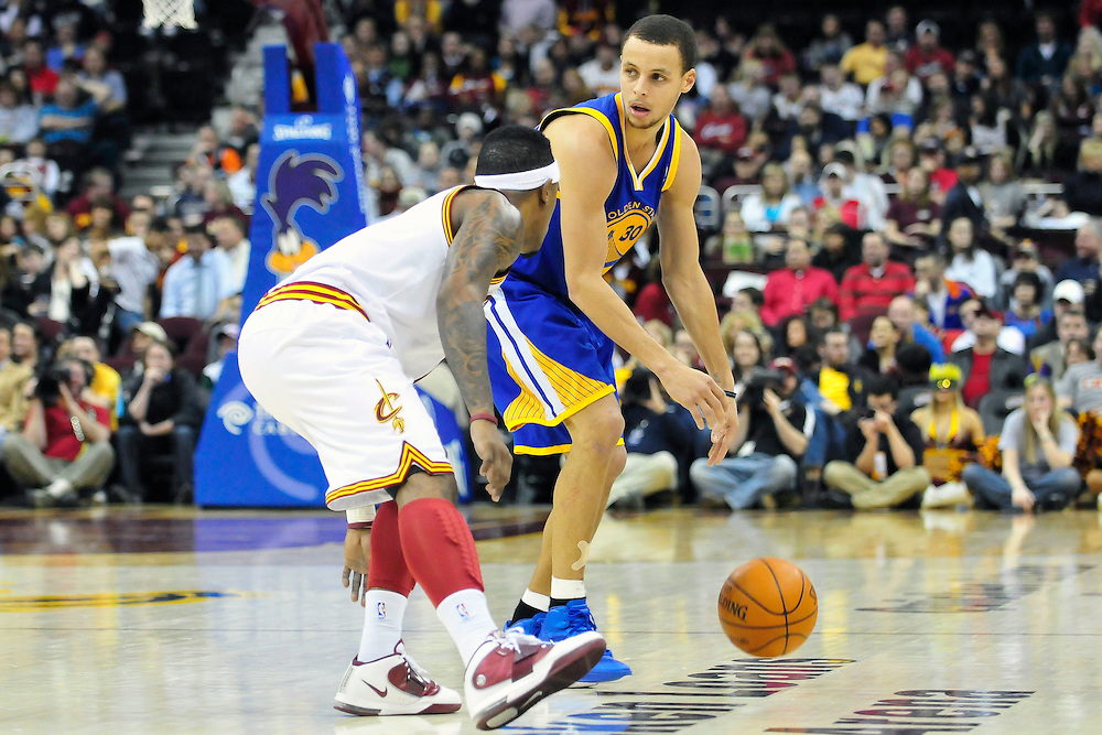 March 8, 2011; Cleveland, OH, USA; Cleveland Cavaliers point guard Daniel Gibson (1) puts pressure on Golden State Warriors point guard Stephen Curry (30) during the fourth quarter at Quicken Loans Arena. The Warriors beat the Cavaliers 95-85. Mandatory Credit: Jason Miller-US PRESSWIRE