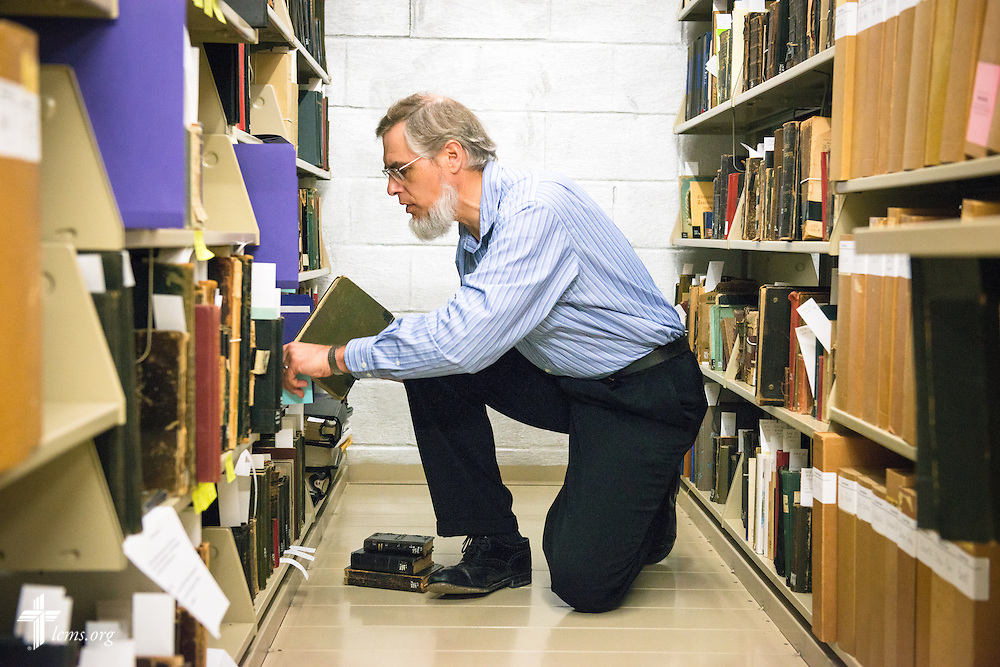 Mark Bliese, reference assistant, shelves books in the archives Monday, July 21, 2014, at Concordia Historical Institute on the campus of Concordia Seminary in Clayton, Mo.  LCMS Communications/Erik M. Lunsford