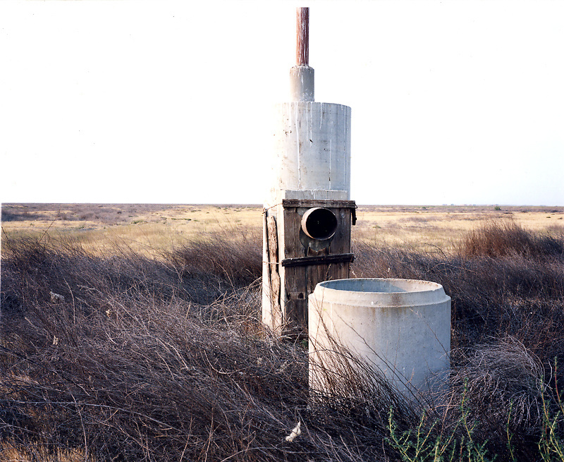 A possible remnant from early irrigation infrastructure in the Tulare Basin, sits unused on unused land within the one hundred and forty thousand acre farm.