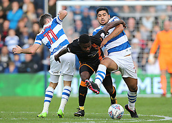 Wolves Bright Enobakhare is fouled by QPR's Massimo Luongo during the Sky Bet Championship match at Loftus Road, London.