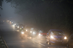 © London News Pictures. 16/10/2013. London, UK.  Cars using their headlights in thick fog in the early morning in Hempstead, North London. Parts of the UK have woken to thick fog this morning. Photo credit: Ben Cawthra/LNP