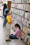 Yeongpung Book Store, the country's second largest. Kids test-reading potential buys.