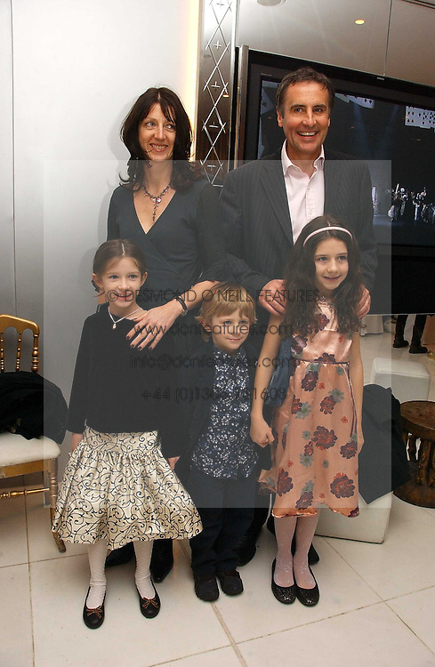 News reader DERMOT MURNAGHAN and his wife with their children left to right, ALICE, JACK and MOLLY at the English National Ballet's Mad Hatters Tea Party at St.Martins Lane Hotel, St Martins Lane, London on 12th December 2006.<br />