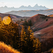 Autumn sunset across ridgelines towards the Tetons.