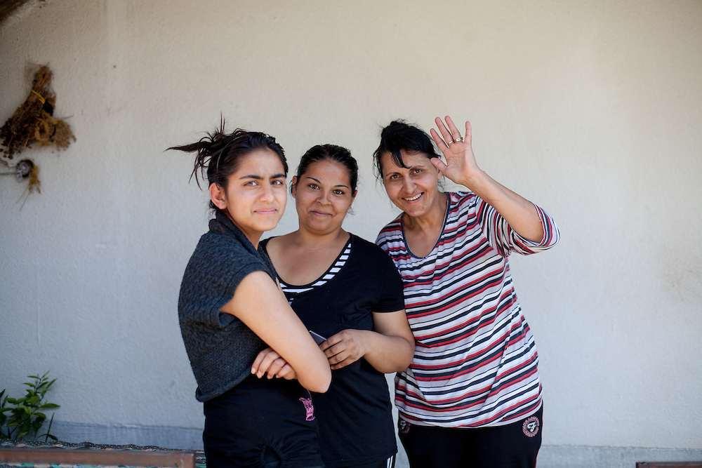 Portrait of three woman living in the Roma part of the city of Crnik, Macedonia.
