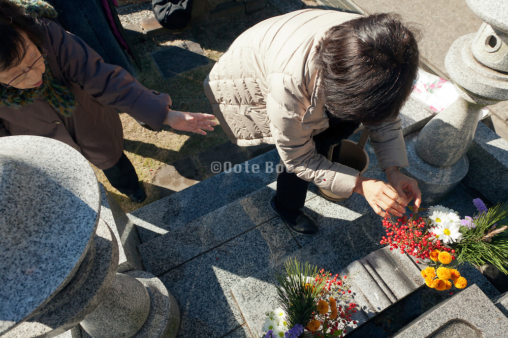 flower offering at the family grave Japan