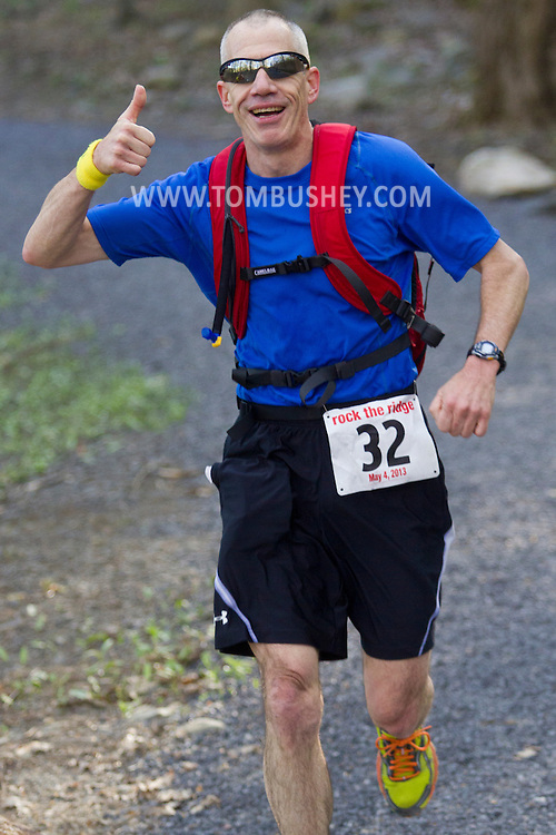 Gardiner, New York - Michael Embler competes in the Rock the Ridge 50-mile endurance challenge race at the Mohonk Preserve on May 4, 2013. The race is part of Mohonk's 50th anniversary celebration and a fundraiser for the preserve.