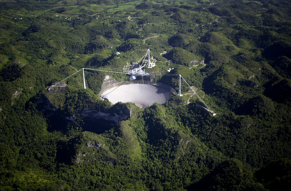 Aerial views of Arecibo Observatory, radio telescope,from a United States Coast Guard HH-65B helicopter, stationed at USCG Air Station Borinquen, Puerto Rico. The primary mission of Coast Guard Air Station Borinquen is search and rescue. (U.S. Air Force photo/ Master Sgt. Lance Cheung)